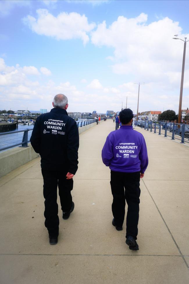 Community Wardens walking along the riverside promenade