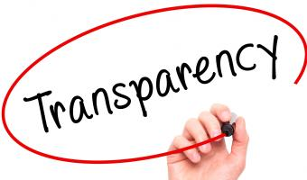 Someone circling around the word Transparency