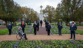 Representatives of the Town standing next to the War Memorial at Remembrance Sunday 2020