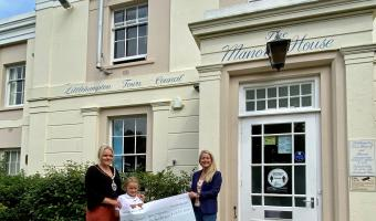 Town Mayor Councillor Michelle Molloy presenting cheque to Treasure Basket outside the Manor House
